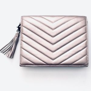 Neiman Marcus pewter quilted leather clutch.
